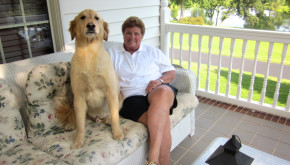 Debbie Clay and her golden retriever relaxing on their front porch.