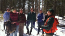 Maine Forest Service district forester Patty Cormier teaches women woodland owners about tree measurement