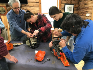 Women's chainsaw safety and maintenance
