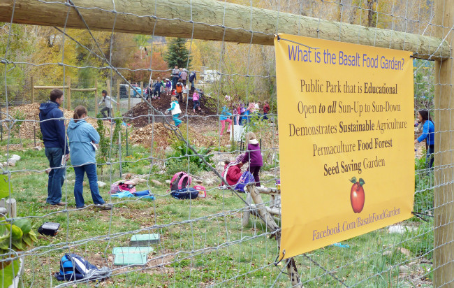 Teachers and students explore a forest food garden in Basalt, CO.